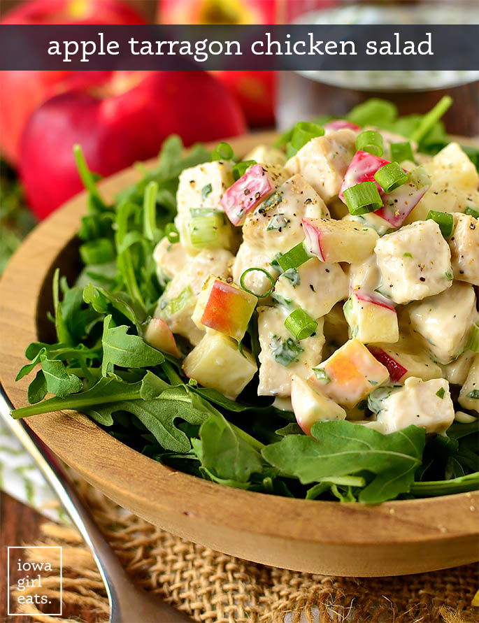 apple tarragon chicken salad scooped over a bowl of lettuce