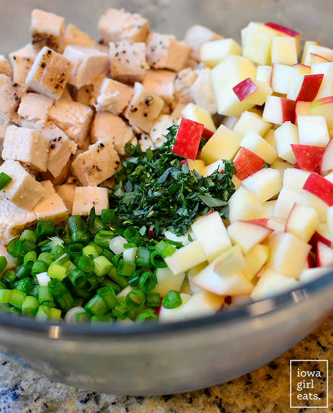 ingredients for apple tarragon chicken salad in a mixing bowl