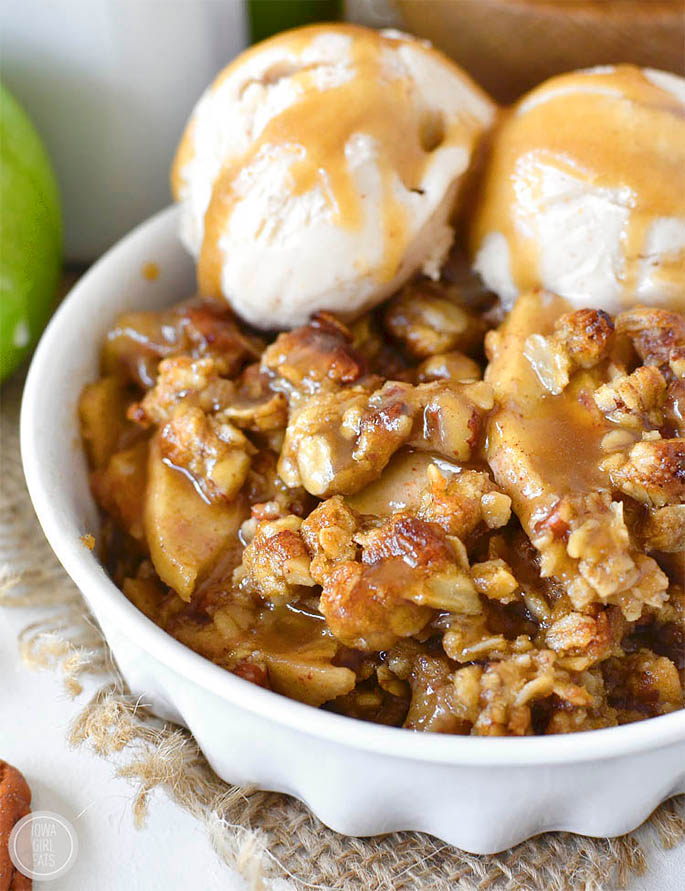 Caramel Apple Crisp with Easy Caramel Sauce is decadent and delicious gluten-free dessert recipe. Serve warm with a scoop of ice cream for a heavenly fall treat! | iowagirleats.com