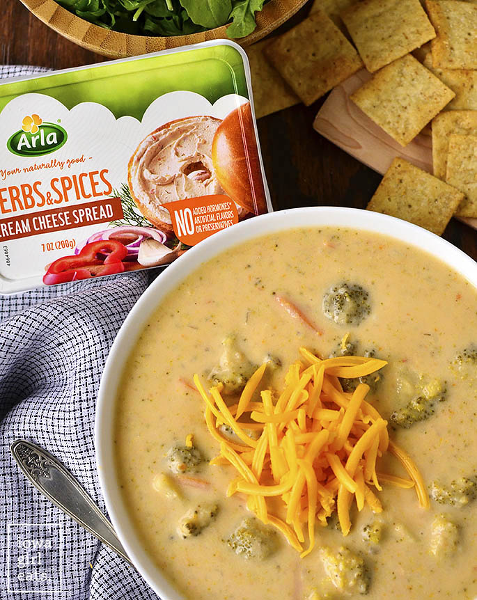 Crock Pot Broccoli-Cheddar Potato Soup is thick, creamy, and oh-so cheesy. This crock pot soup recipe is easy andgluten-free, too! | iowagirleats.com