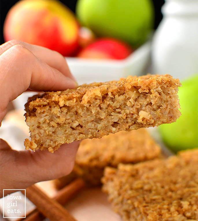 Hand holding apple oatmeal bar