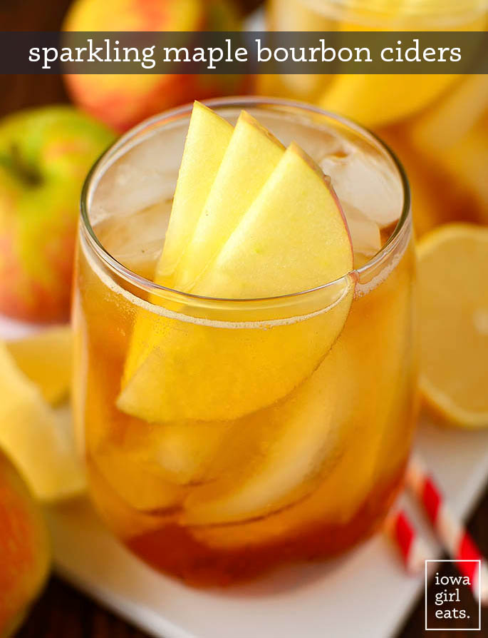maple bourbon cider in a glass with apple garnish