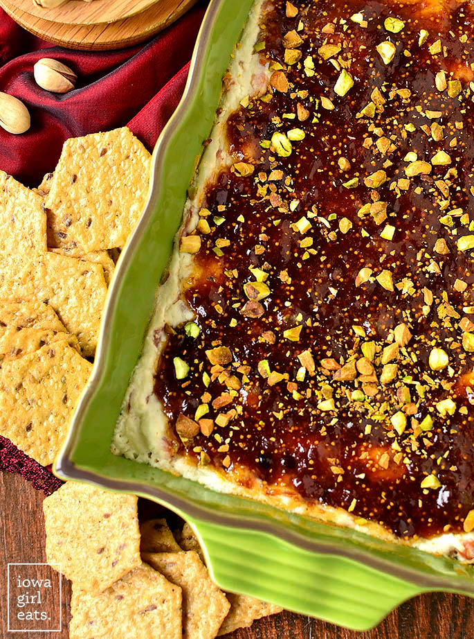 pistachio topped warm fig and prosciutto goat cheese dip