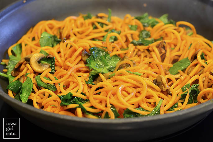 Spinach, Bacon and Mushroom Sweet Potato Noodles is a healthy and filling, 1-skillet dinner recipe that's packed with vegetables. Cooks in under 20 minutes, too! | iowagirleats.com