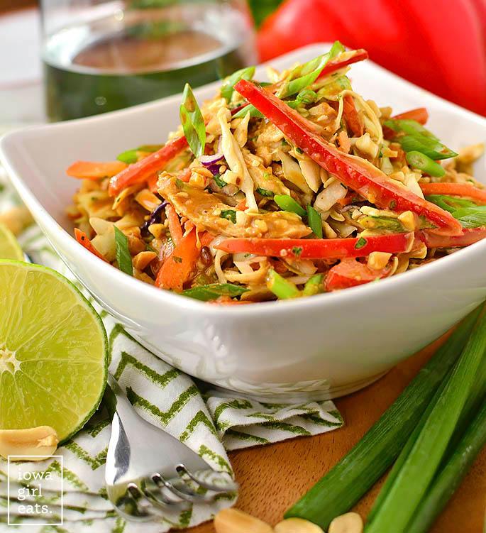 thai crunch salad in a bowl with peanut dressing