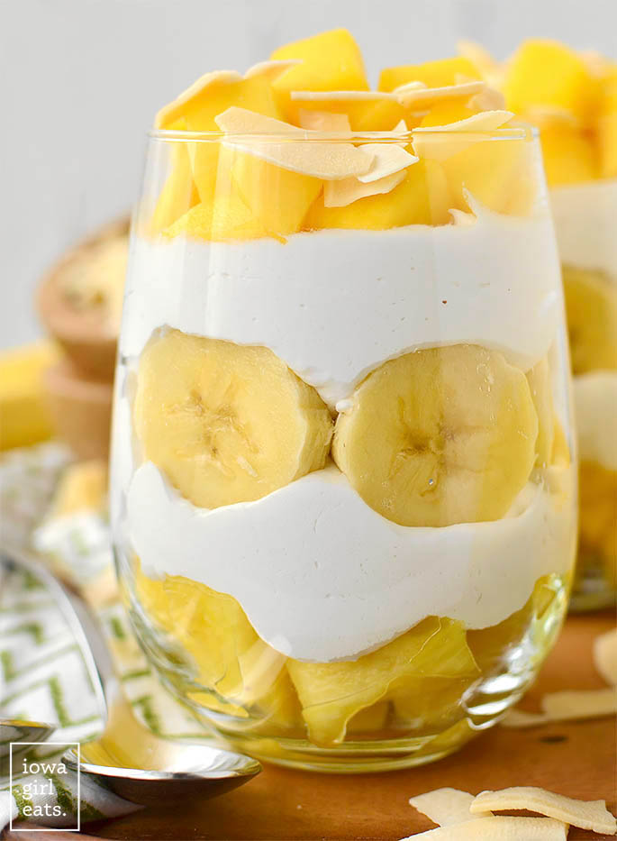 layered pina colada parfait in a glass
