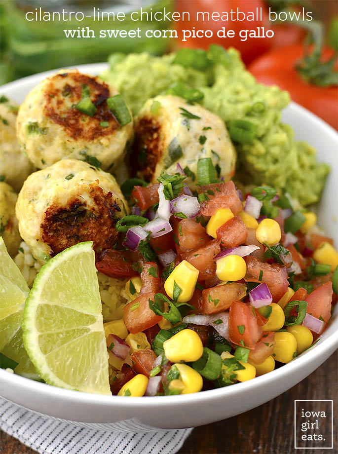 Cilantro-Lime Chicken Meatball Bowls with Sweet Corn Pico de Gallo and Cauli-Rice are a fresh and flavorful gluten-free lunch or dinner recipe. Prep once and enjoy all week long! | iowagirleats.com