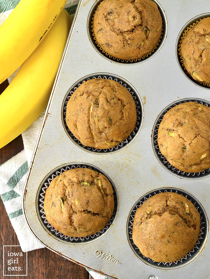 Healthier Zucchini Banana Bread Muffins are soft, squishy, and just sweet enough. Pair with coffee or tea for a tasty,gluten-free snack or breakfast idea! | iowagirleats.com
