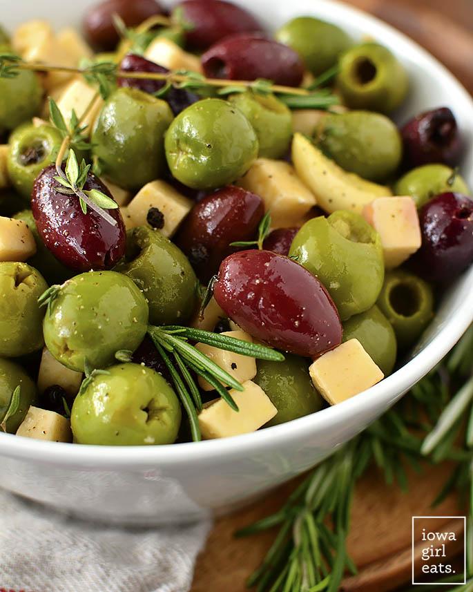Bowl of mixed olives, herbs, and garlic.