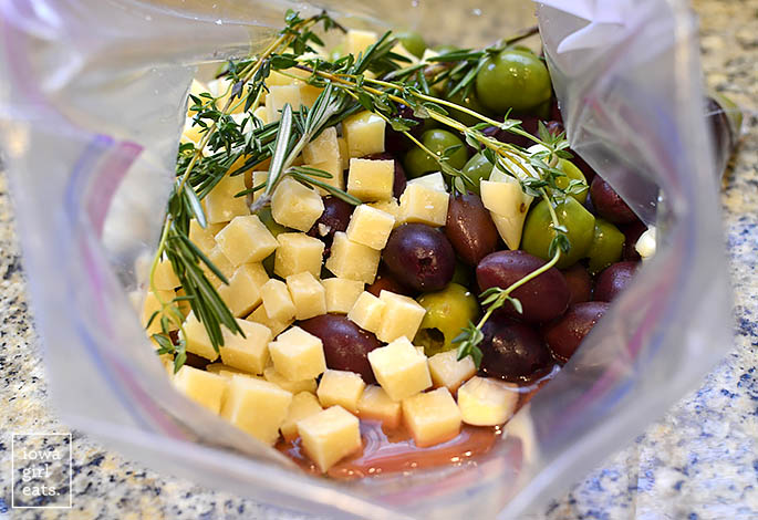 Ziplock bag of olives, cheese, and herbs.
