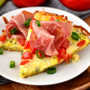 slices of hash brown crust breakfast pizza on a plate
