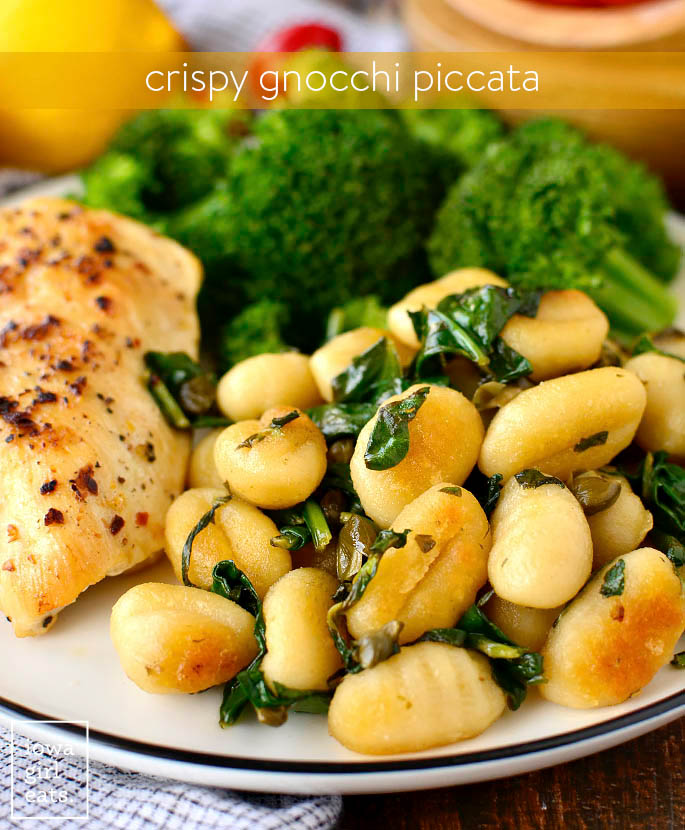 crispy gnocchi piccata on a plate with chicken and broccoli