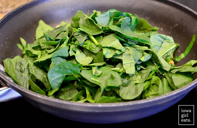 spinach wilting in a skillet