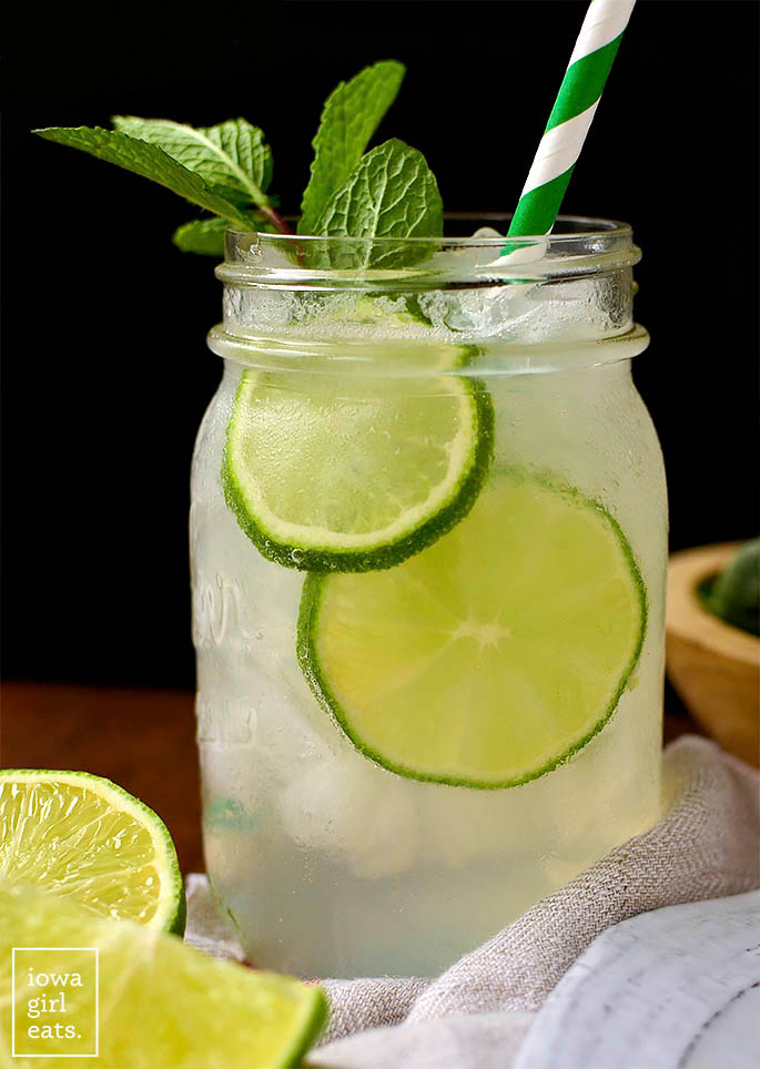 sparkling mint limeade in a mason jar with a straw