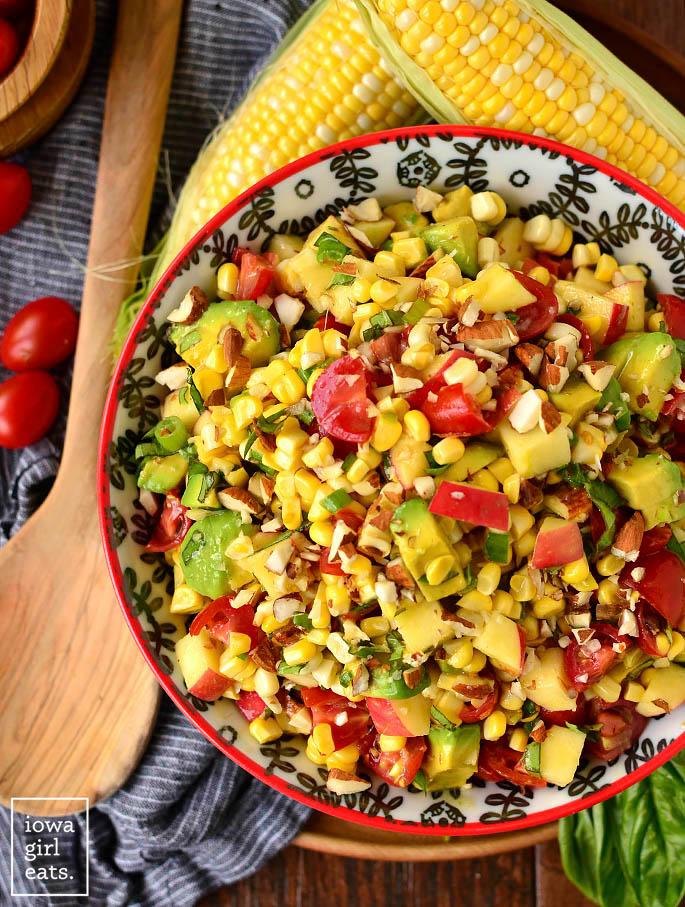 overhead photo of a bowl of napa sweet corn salad