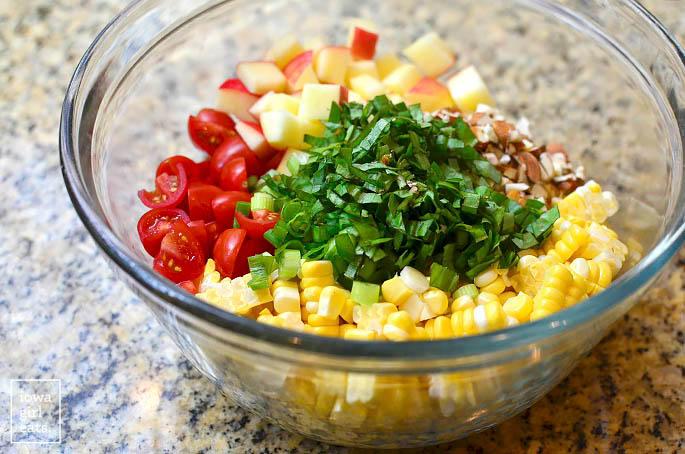 sweet corn salad ingredients in a bowl