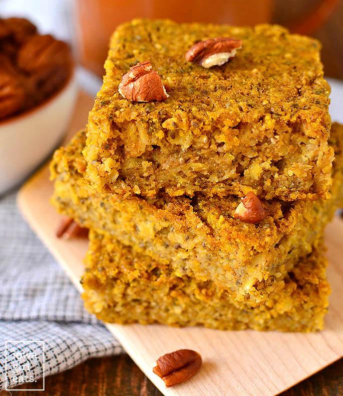 maple pumpkin oatmeal breakfast bars stacked on a plate