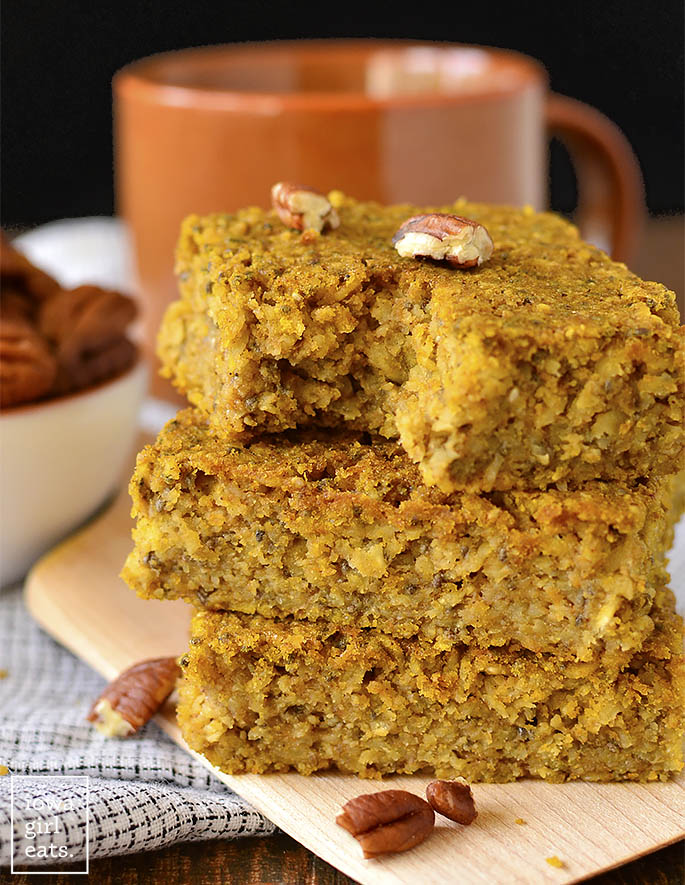 Maple Pumpkin Oatmeal Breakfast Bars with a bite taken out of them