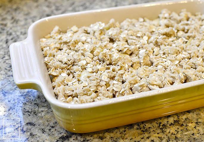 unbaked gluten free apple crisp in a baking dish