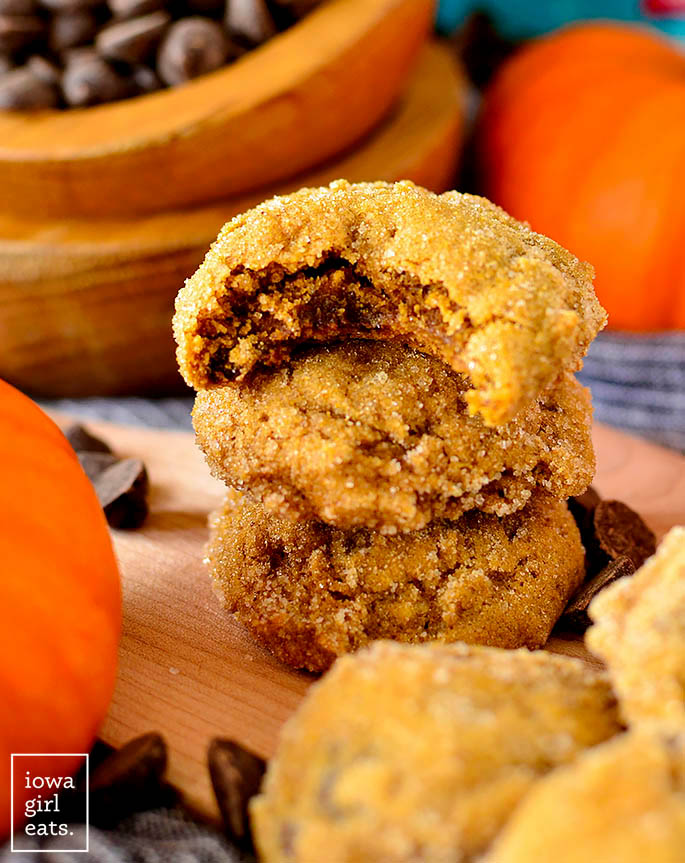 Soft batch pumpkin gingersnap cookie sitting on a stack of cookies