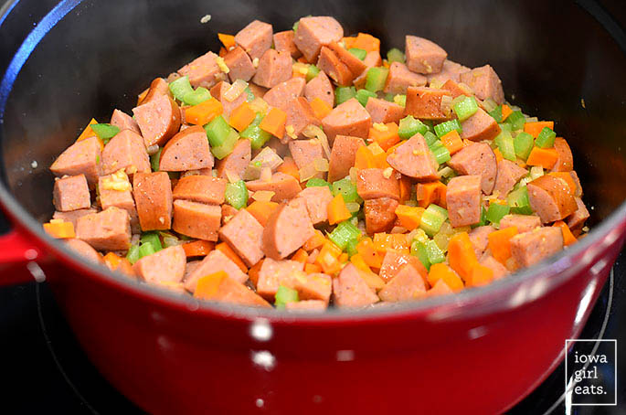 tuscan sausage and vegetable stew ingredients in a pot
