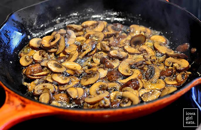 garlic butter mushrooms sauting in a skillet
