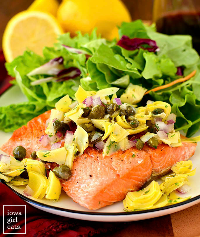 salmon with artichoke salsa and capers on a plate