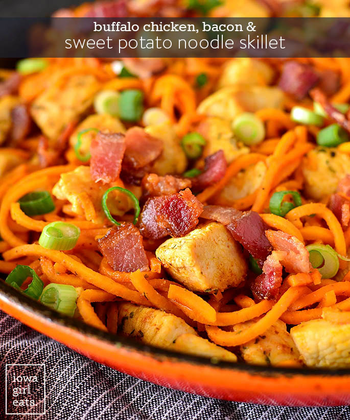 buffalo chicken bacon and sweet potato noodle skillet in a cast iron skillet