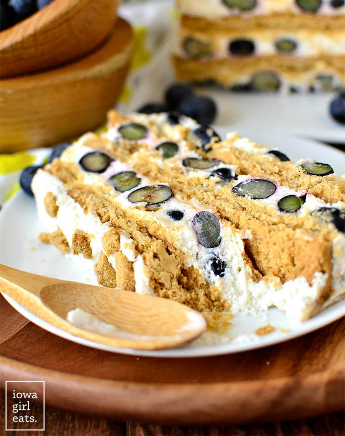slice of blueberry lemon icebox cake with a spoonful eaten out of it