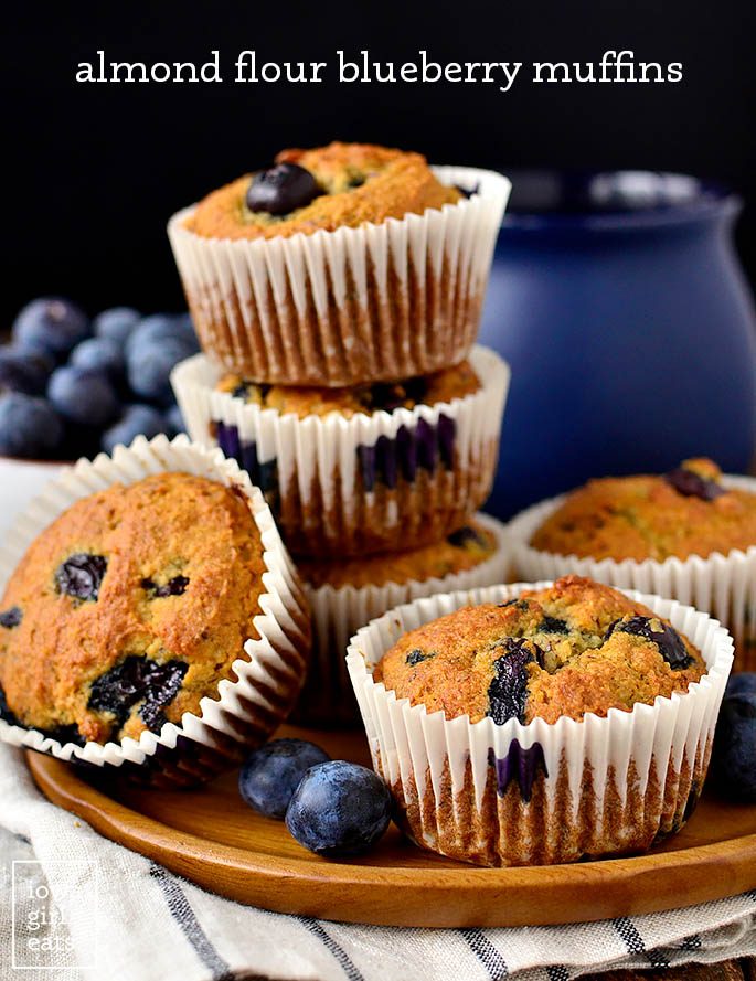 almond flour blueberry muffins stacked on a plate