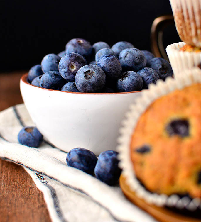 fresh blueberries cascading out of a bowl