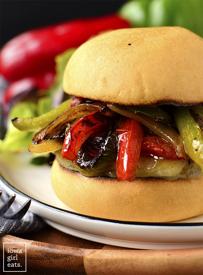 Close up of Italian Sausage and Peppers Cheeseburgers on a bun