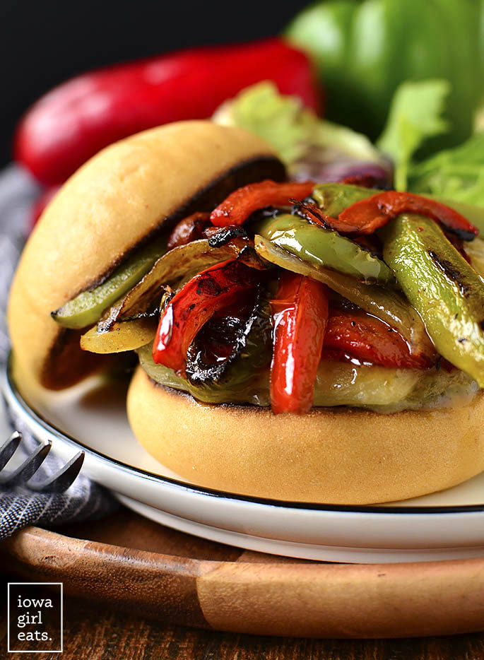 Close up photo of Italian Sausage and Peppers Cheeseburgers on a plate.