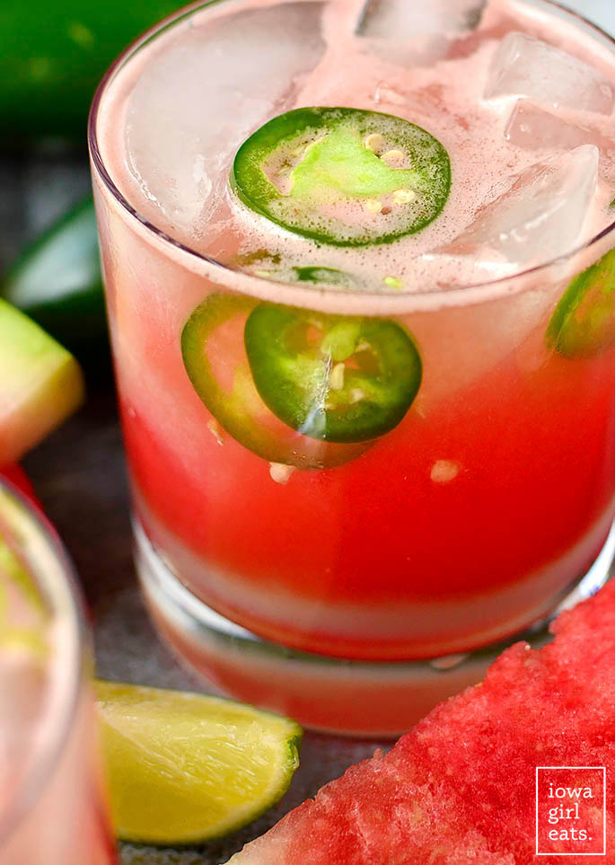 close up photo of watermelon jalapeno margarita in a glass