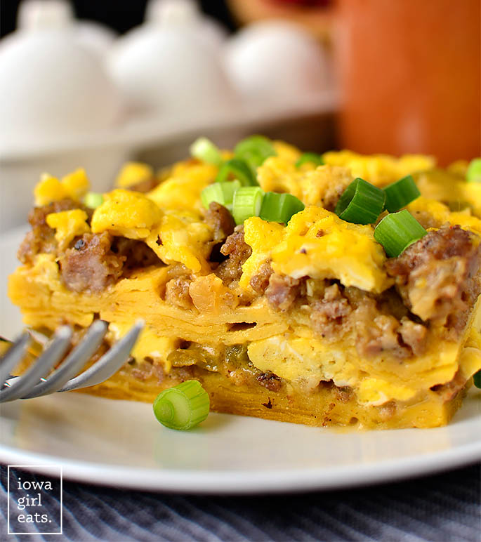 slice of breakfast taco casserole on a plate with a fork