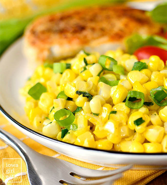 scoop of summer sweet corn saute side dish on a plate