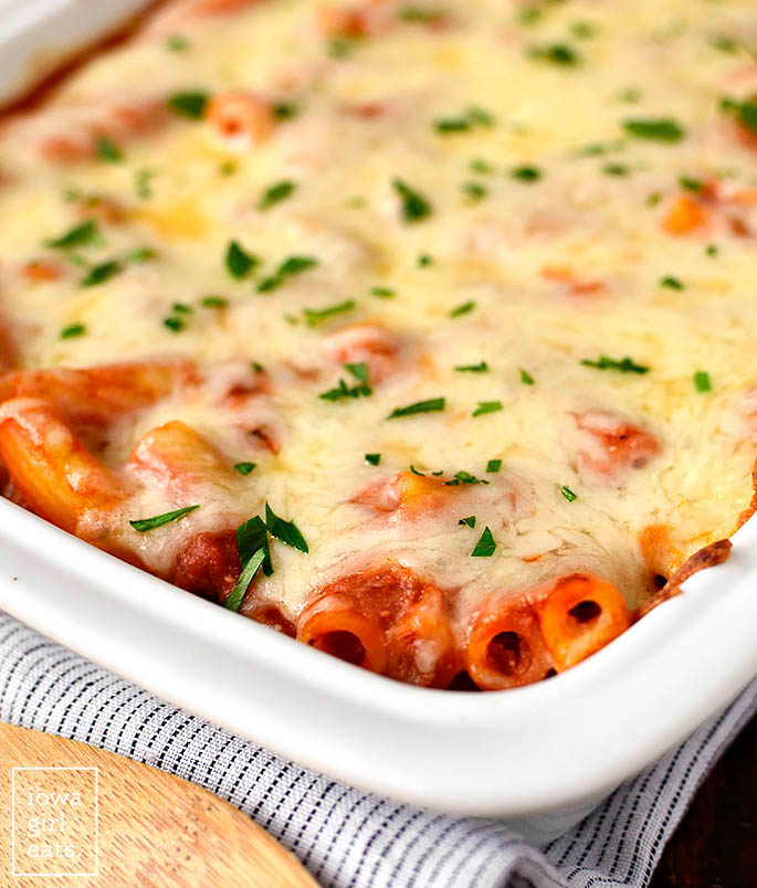 cheese covered baked ziti in a casserole dish