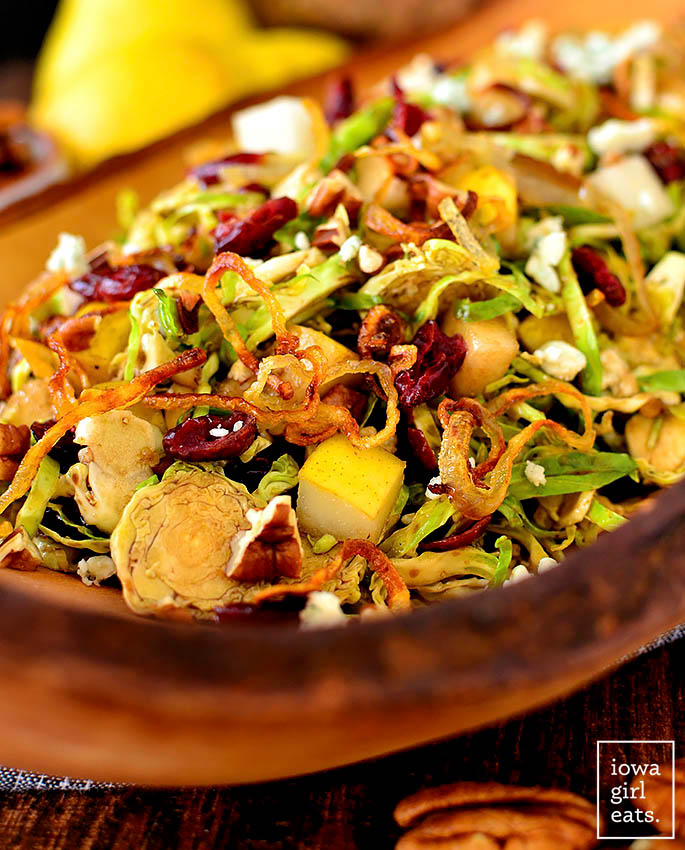 Shredded Brussels Sprouts Salad in a wooden serving bowl