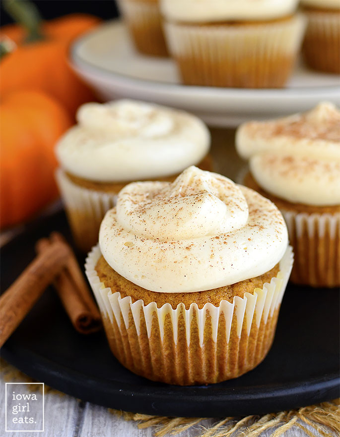 Black plate with Gluten Free Pumpkin Cupcakes on it
