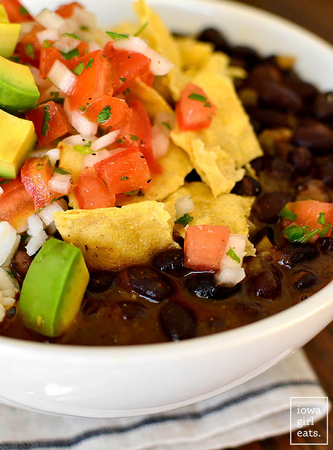 Close up photo of a bowl of black bean soup