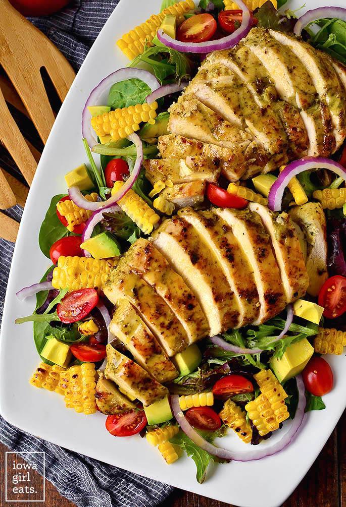 grilled sliced chicken on a salad
