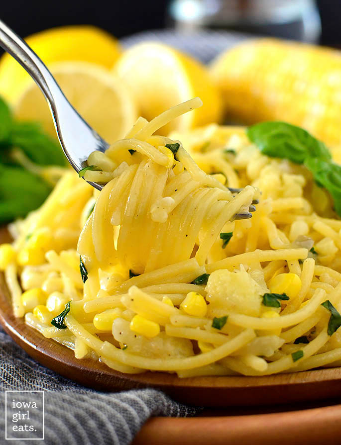 A fork twirling a bite of Creamy Sweet Corn Pasta with Basil