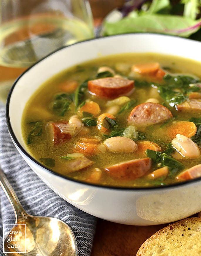 Bowl of Smoked Sausage, White Bean and Spinach Soup