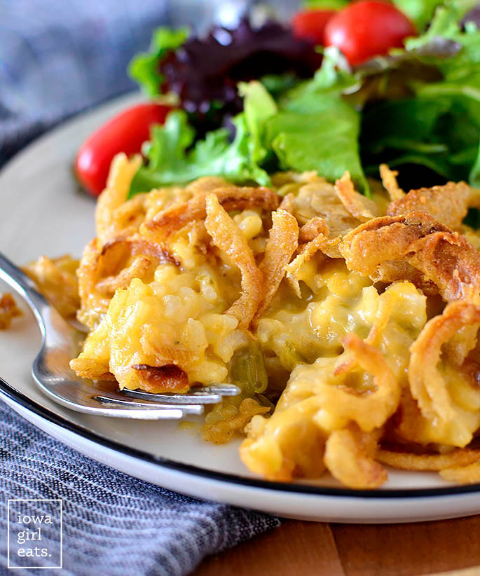 Cheesy chicken and rice green bean casserole on a plate with a fork