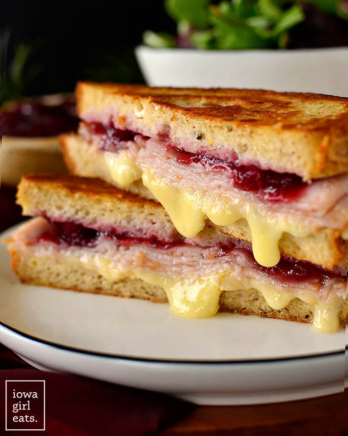 close up photo of a melty turkey and cranberry grilled cheese sandwich