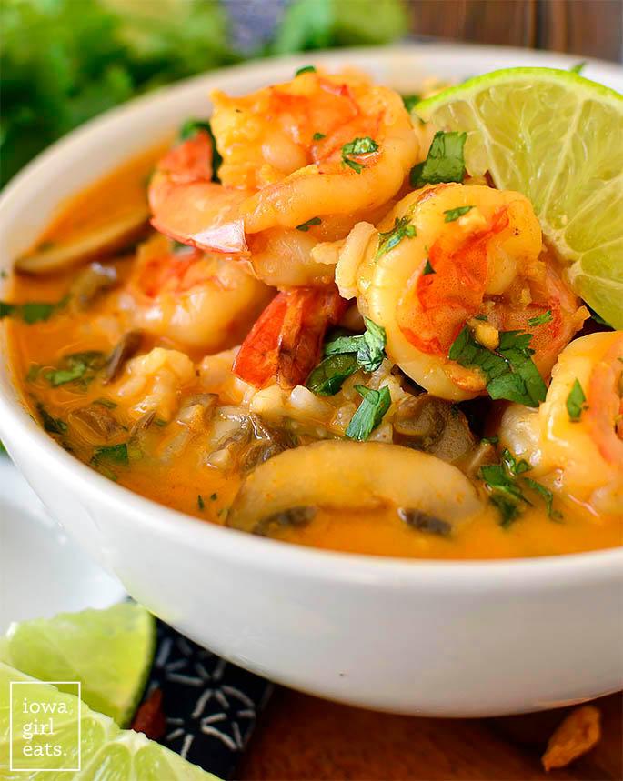 close up photo of a bowl of thai shrimp soup