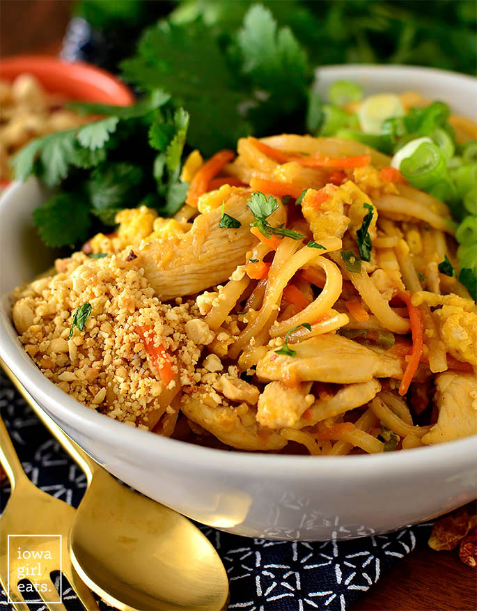 Bowl of Chicken Pad Thai with condiments