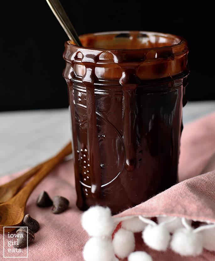 Homemade hot fudge sauce dripping down a jar
