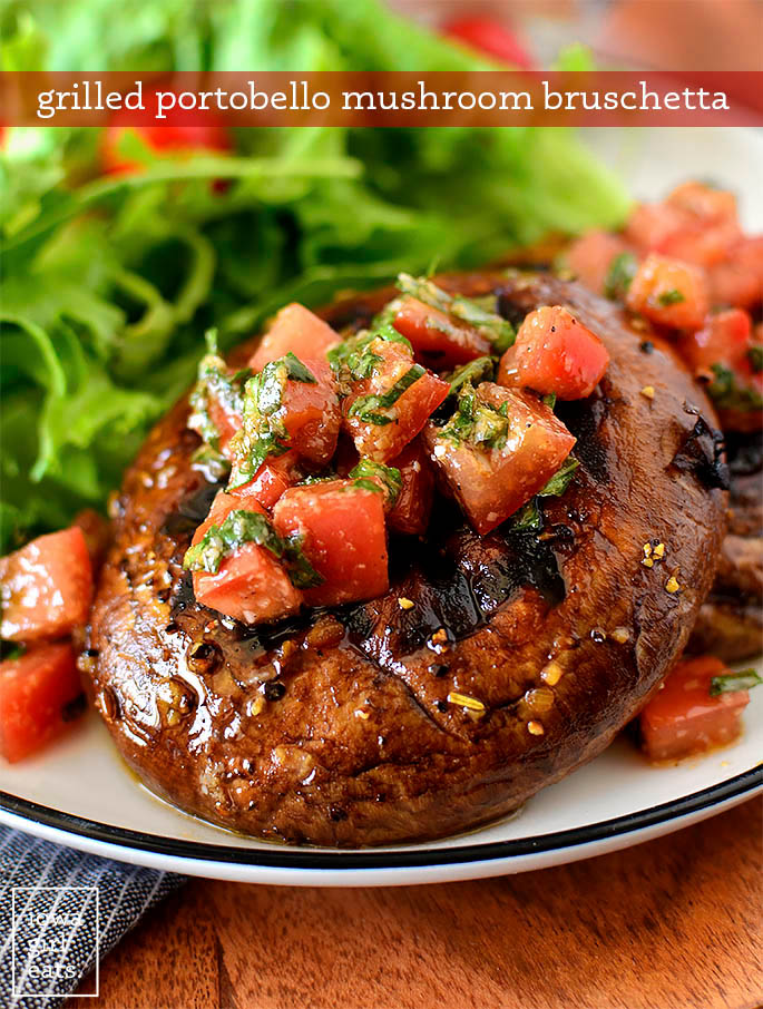 close up Photo of a grilled portobello mushroom with bruschetta topping