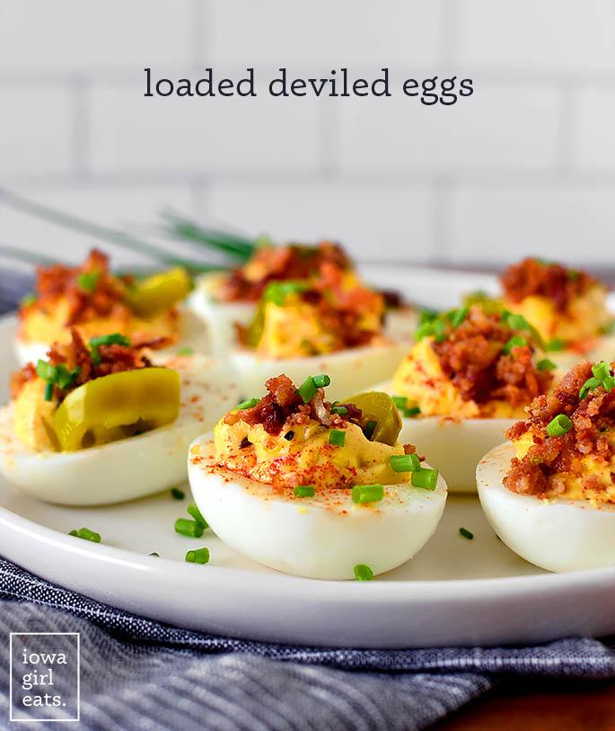 Loaded deviled eggs on a platter